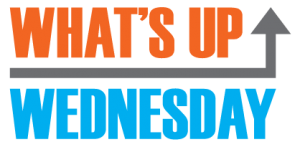 "Sign that says ""What's Up Wednesday"" in orange and blue with a grey arrow"
