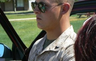 Testimony from Combat Warrior, Matthew Thomas, Headshot of Matt with sunglasses on in uniform