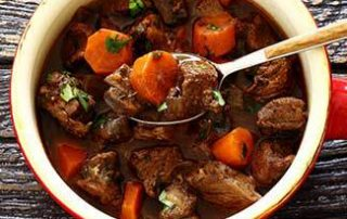 Foodie Friday - Beef Stew - a bowl full of beef stew, a spoon full someone is about to take