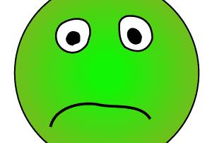 How Antibiotics Wreak Havoc on your gut, a green sad sick face