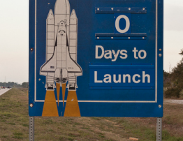 """Happy Launch Day! Picture of a highway sign with a rocket ship and the words beside it """"0 days to Launch"""""""