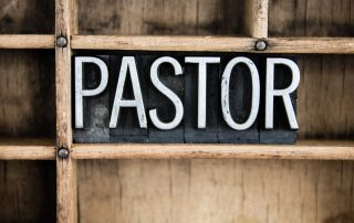 What Pastors Are Saying About Starting Their Journey Into The ReStart Your Heart Program, the word pastor on a chalkboard with wood rustic background