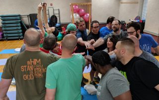 Pastors Find Success in ReStart Your Heart Wellness Program, group with all hands in