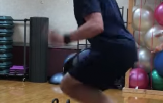Superhero Powered Pastor, Pastor in dark blue t-shirt doing double-unders on the jump rope in the gym