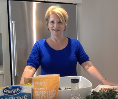 MissionFiT's Lunch Ladies - Episode 003 with Lady Zoe, headshot of Zoe in the kitchen getting ready to cook in a blue shirt
