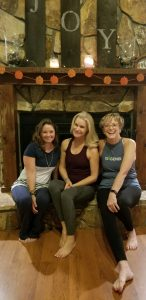 2 Events in 2 Days at MissionFiT!, 3 ladies sitting smiling in front of the fire place
