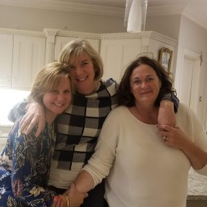 From Cardio to Cardiac Arrest and Back, three ladies posing for the camera hugging in the kitchen
