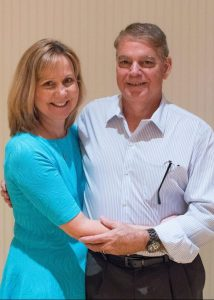 Testimony Tuesday with Joy Motte, Joy smiling with her husband