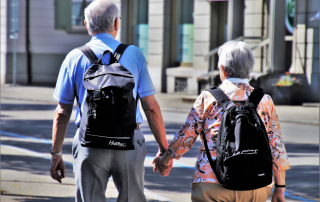 Keys to Better Health for Seniors, 2 elderly people walking with backpacks