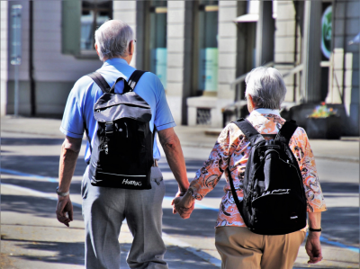 Keys to Better Health for Seniors, 2 elderly people walking with backpacks