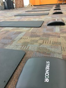 Another Round of Graduates Complete ReStart Your Heart, picture of ab mats and yoga mats set out for a workout