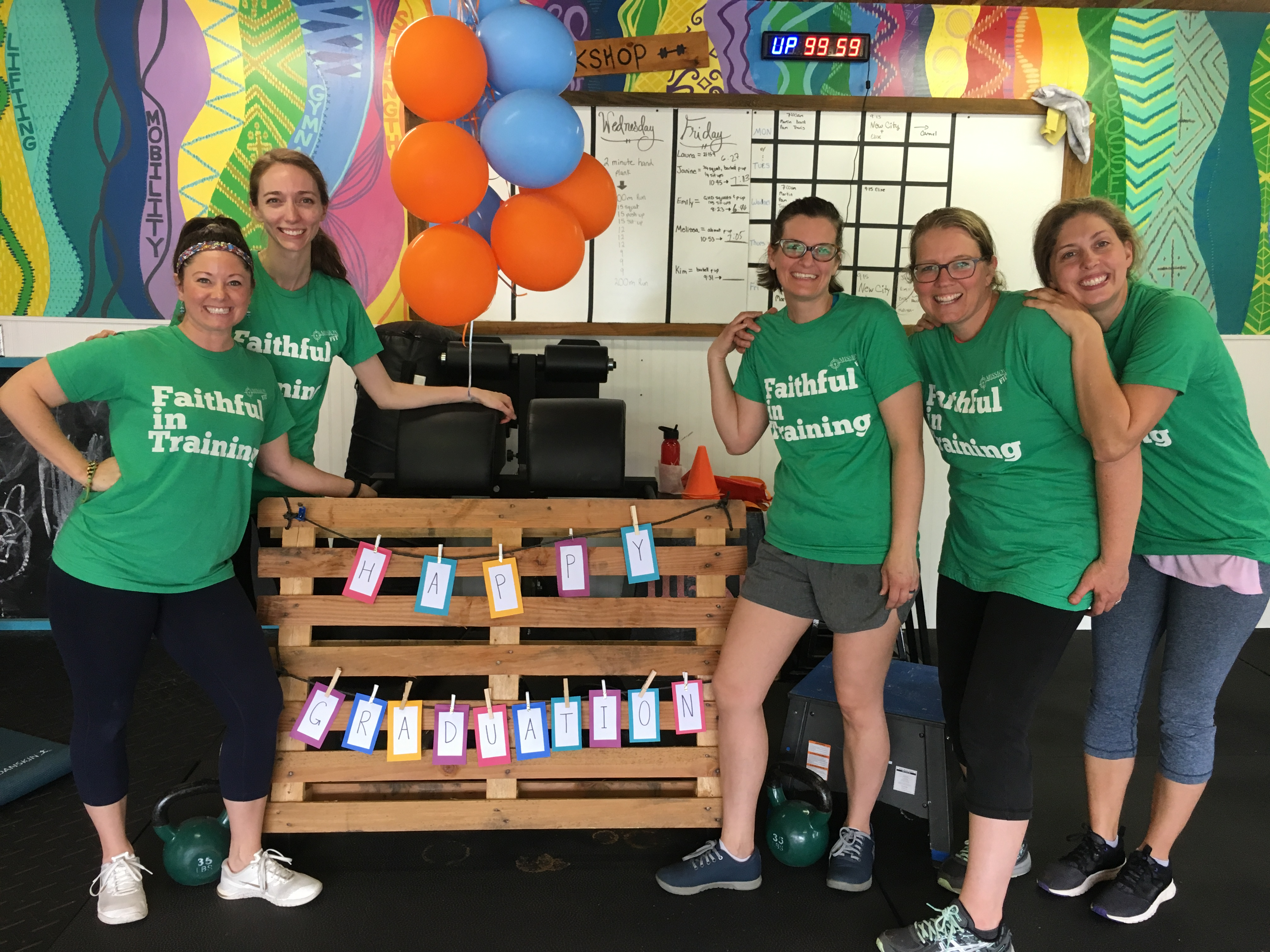 Amazing G-Race, picture of 4 ladies in green shirts posing for the camera