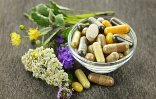 3-2-1-Go to Sleep! Here's Why... (Part 5), photo of pills in a bowl with flowers next to it.