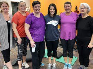 The Graduates. 6 women smiling after a workotu