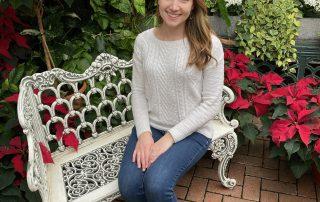 Emily Snodgrass, headshot sitting on bench
