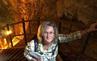 Sally climbing stairs in a cavern