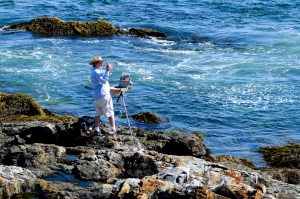 Man painting by the seaside at Arcadia National Park, Maine. Join MissionFiT's Challenge The National Parks! Week 2