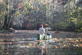 2 people canoeing on a Cedar Creek Congaree Challenge The National Parks Hike